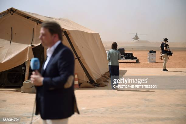 Journalists make live report prior to the visit of French President to the troops of France's Barkhane counter-terrorism operation in Africa's Sahel...