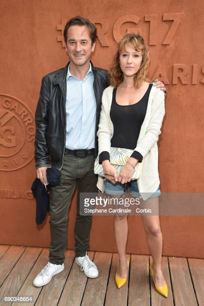 Journalists Nathanael de Rincquesen and Julia Livage attend the 2017 French Tennis Open Day Three at Roland Garros on May 30 2017 in Paris France