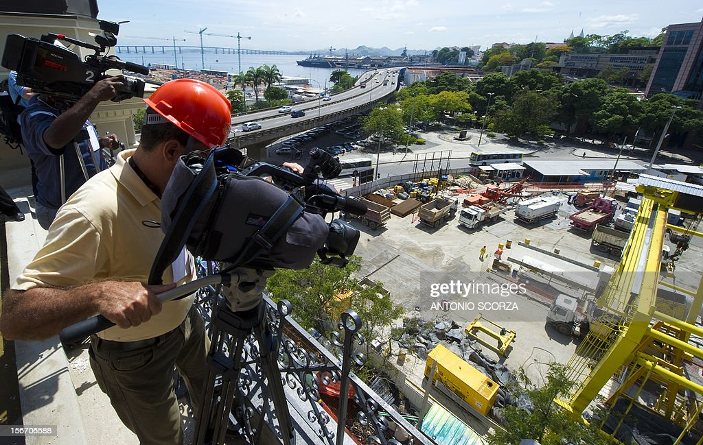 Journalists observe from atop a building the works at the Maravilha Port area during a tour organized by the Rio 2016 Committee on November 19, 2012 in Rio De Janeiro, Brazil.