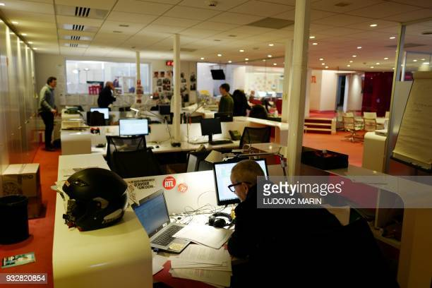 Journalists of French radio station RTL radio present a programme in their historical headquarters at Bayard Street in central Paris on March 16...