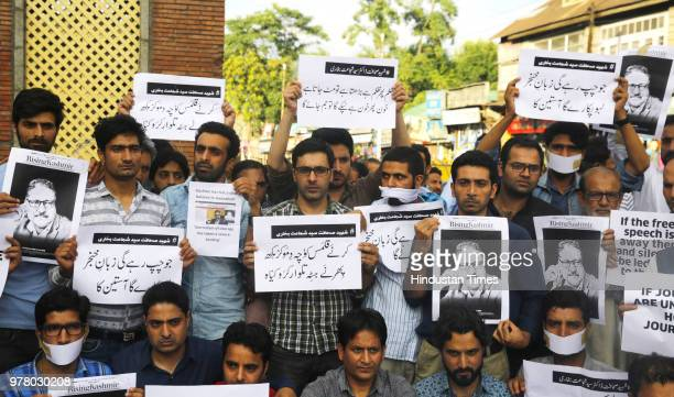 Journalists of Rising Kashmir joined by other journalists from various media hold placards during sitin protest against the killing of Shujaat...