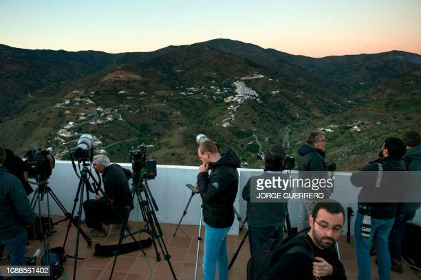 Journalists on January 25 2019 take images of the rescue works to reach twoyearold Julen Rosello who fell down a well in Totalan southern Spain...