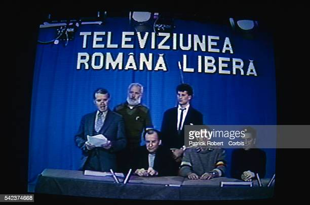 Journalists on Romania Free television station reading a bulletin during a broadcast during the December 1989 uprising which marked the end of...