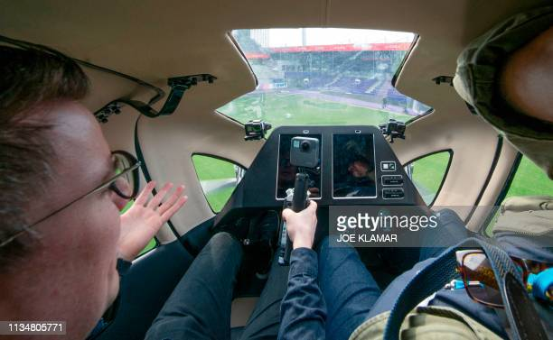Journalists onboard of an Air Taxi EHANG 216 take a short flight during a press preview of FACC AG on Urban Air Mobility at Generali Arena in Vienna...
