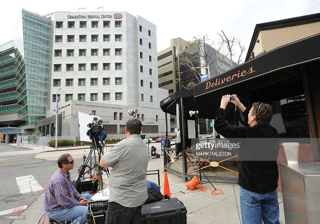Journalists outside the Cedars-Sinai Medical Center where