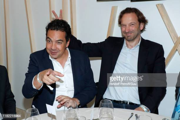 Journalists Patrick Cohen and Francois Busnel attend the 'France Television' Lunch during the 2019 French Tennis Open - Day Three at Roland Garros on...