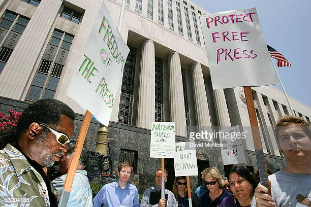 Journalists pause for a moment of silence as they demonstrate outside the federal courthouse July 6 2005 in Los Angeles California Reporters...