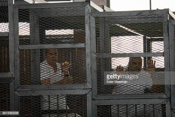 CONTENT] Journalists Peter Greste and Mohammed Fahmy are seen behind bars locked up in a cage in an Egyptian courthourse at the Al Jazeera trial in...