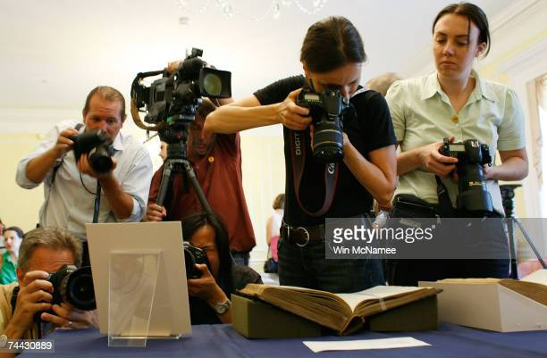 Journalists photograph a newly discovered letter written by Abraham Lincoln displayed at the National Archives June 7 2007 in Washington DC Lincoln's...