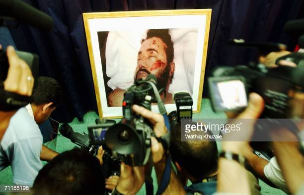 Journalists photograph and take video of a picture of the killed leader of alQaeda in Iraq Abu Musab alZarqawi June 8 2006 in Baghdad Iraq Iraqs...