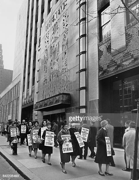 Journalists picketing the Daily News Building the headquarters of the New York Daily News in 42nd Street New York November 1962 They are on strike...