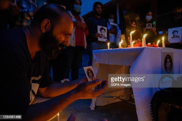 Journalists prays for Danish Siddiqui during a candle light vigil in his remembrance Srinagar. Reuters journalist Danish Siddiqui was killed on...