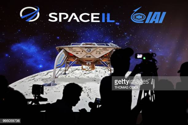 Journalists prepare to attend a press conference by Israeli Aerospace Industries space division to announce the launch of an spacecraft to the moon...