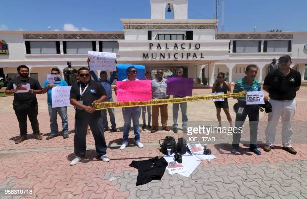 Journalists protest for the murder of their colleague Jose Guadalupe Chan outside the City Hall in Playa del Carmen, Quintana Roo state, Mexico on...