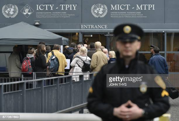 Journalists queue to enter the International Criminal Tribunal for the former Yugoslavia in The Hague on November 22 to attend the verdict in the...