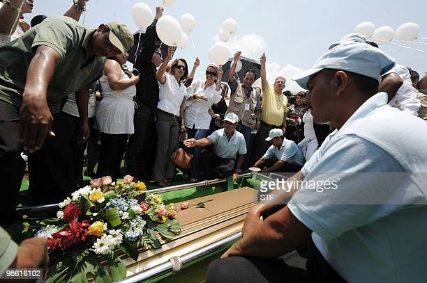 Journalists release balloons during the burial of television journalist and university professor Jorge Alberto Orellana in San Pedro Sula 240 km...