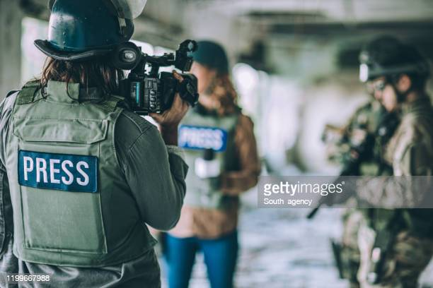 journalists reporting from the war zone - journalist stock pictures, royalty-free photos & images