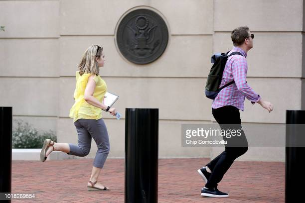 Journalists run back into the Albert V Bryan US Courthouse during the second day of jury deliberation in former Trump campaign chairman Paul...