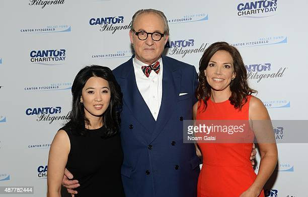 Journalists Scarlet Fu Tom Keene and Erica Hill attend the annual Charity Day hosted by Cantor Fitzgerald and BGC at Cantor Fitzgerald on September...