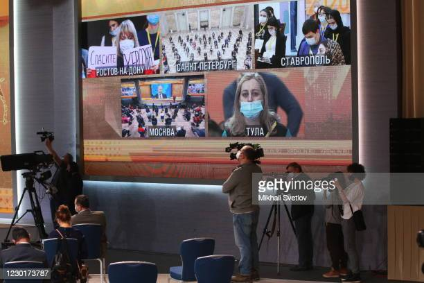 Journalists seen on the screen during Vladimir Putin's annual press conference, on December 17 in Moscow, Russia. This year about 250 journalists...
