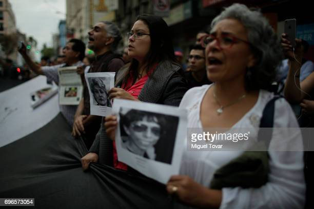 Journalists shout for justice during a demonstration to end violence against journalists in Mexico outside the Palacio de Bellas Artes on June 15...