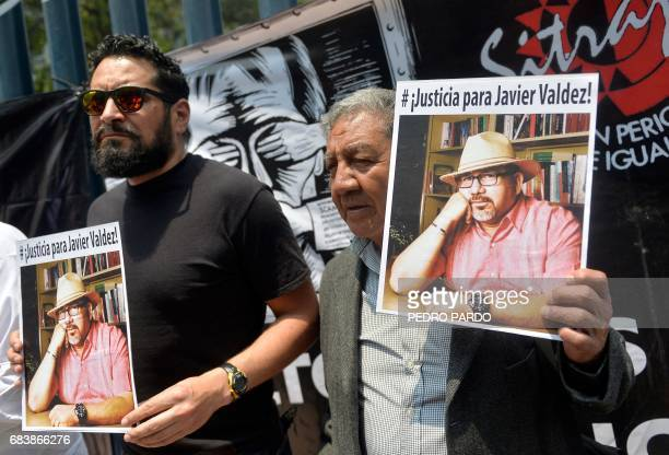 Journalists show pictures of Mexican journalist Javier Valdez murdered on the eve during a protest by journalists in Mexico City on May 16 2017...