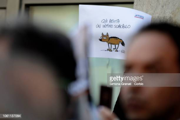 Journalists show their professional cards and display signs saying 'a jackal lives here' during a flash mob to denounce political attacks against the...