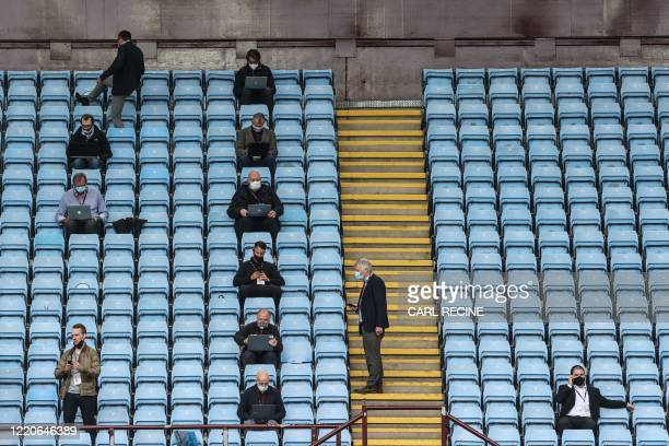 Journalists sit in the stands observing social distancing prior to the English Premier League football match between Aston Villa and Sheffield United...