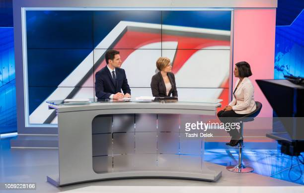journalists sitting with businesswoman - press room stock pictures, royalty-free photos & images