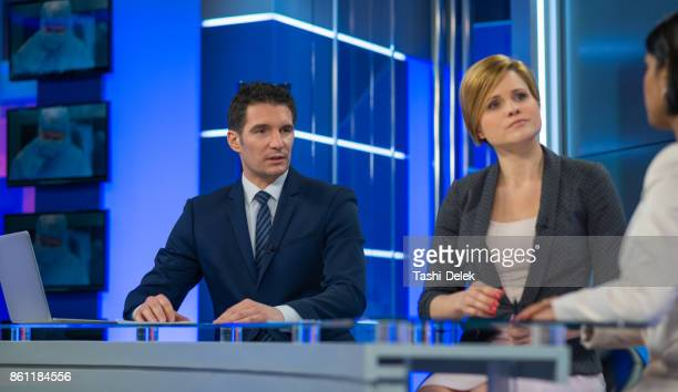 Journalists Sitting With Businesswoman