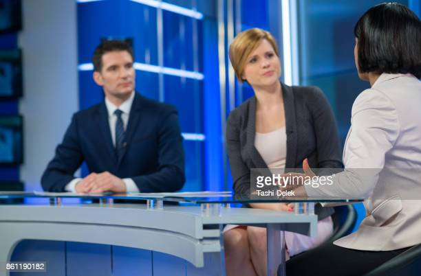 journalists sitting with businesswoman - multimedia stock pictures, royalty-free photos & images