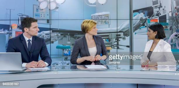 journalists sitting with businesswoman - newscaster stock pictures, royalty-free photos & images