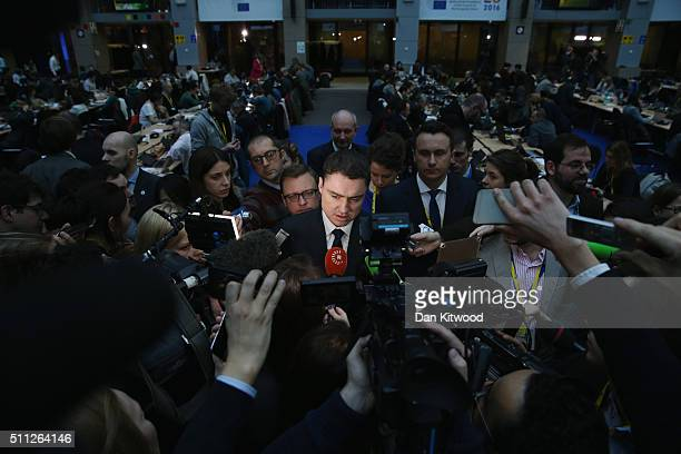 Journalists speak to Estonian Prime Minister Taavi Roivas in the main atrium during the second day of the EU Summit as British Prime Minister David...