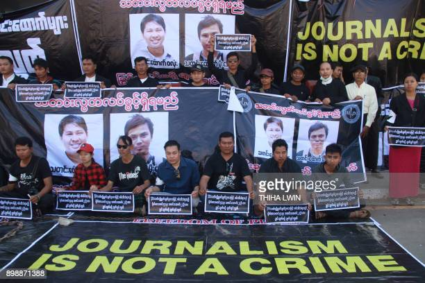 Journalists stage a protest to demand the release of Reuters journalists Wa Lone and Kyaw Soe Oo in Pyaye on December 27, 2017. A pair of Reuters...