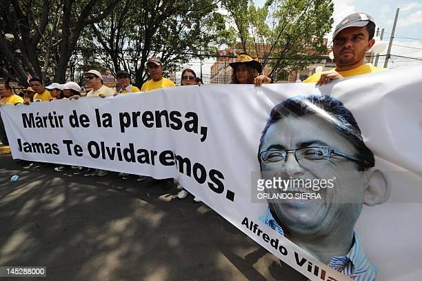 Journalists stand a demonstration demanding punishment for the killers of HRN la Voz de Honduras' journalist Alfredo Villatoro during the celebration...