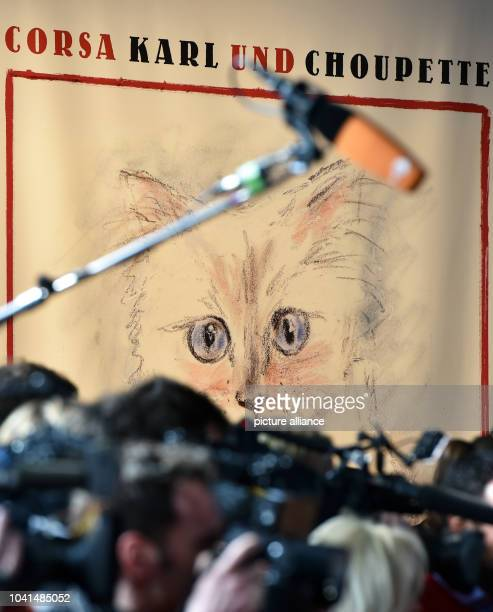 Journalists stand at the vernissage for Karl Lagefeld's photo calender 'Corsa Karl and Choupette' at the Palazzo Italia in Berlin Germany 03 February...
