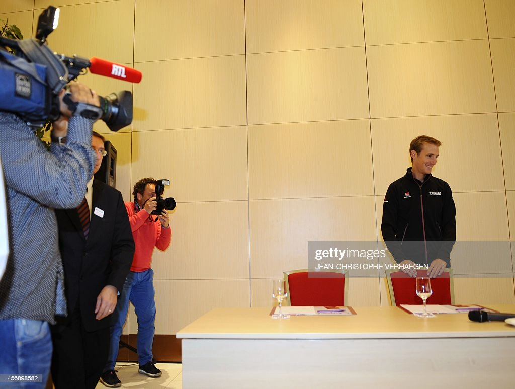Journalists stand by as Luxembourg's Andy Schleck, professional road bicycle racer for UCI ProTour team Trek Factory Racing, arrives to a press conference to announce his retirement, on October 9, 2014 in Mondorf-les-Bains. Schleck won the 2010 Tour de France, being awarded it retroactively in February 2012 after yellow jersey winner Spain's Alberto Contador was stripped of his title, found guilty of a doping offence.
