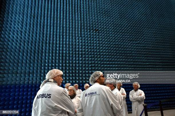 Journalists stand in a room at the Airbus headquarters in Toulouse southern France during a presentation of the SES14 hybride 4ton satellite equipped...