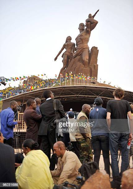Journalists stand in front of the controversial African Renaissance Monument to mark Senegal's 50 years of independence during its inauguration...