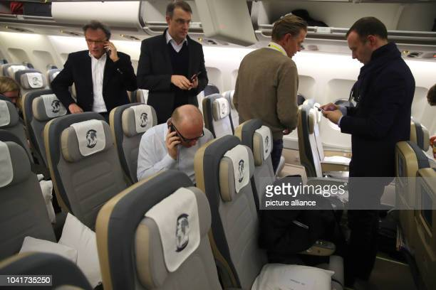 Journalists stand inside the Airbus A340 'Theodor Heuss' of the German Bundeswehr aviation service at Tegel airport in Berlin Germany 13 March 2017...