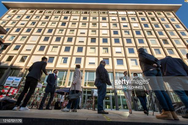 Journalists stand outside the court building prior to the start of a trial against two Syrian defendants accused of state-sponsored torture in Syria,...