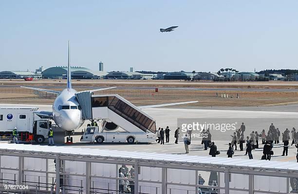 Journalists surround a Skymark jetliner at Ibaraki airport in Omitama Ibaraki prefecture about 80 kilometres northeast of Tokyo the first flight to...