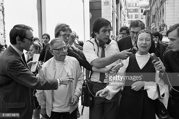 Journalists surround JeanPaul Sartre And Simone de Beauvoir on a Paris street after their release from police custody Sartre and de Beauvoir were...