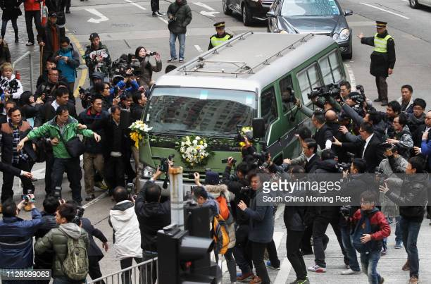 Journalists surround the hearse of Run Run Shaw leaving a funeral home on way to a crematorium in North Point. 10JAN14