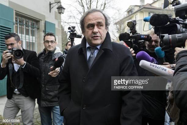 Journalists surround UEFA president and FIFA vice president Michel Platini as he arrives at the Court of Arbitration for Sport to appeal against a...