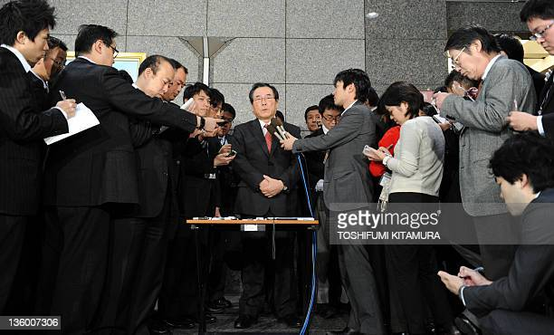 Journalists surrounds Japanese Defense Minister Yasuo Ichikawa during a question and answer session upon his arrival at the defense ministry...