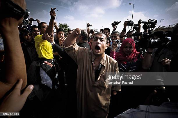 Journalists take footage of a handicapped pro-military protester as he chants against Morsi amidst supporters of Egypt's deposed president Mohamed...
