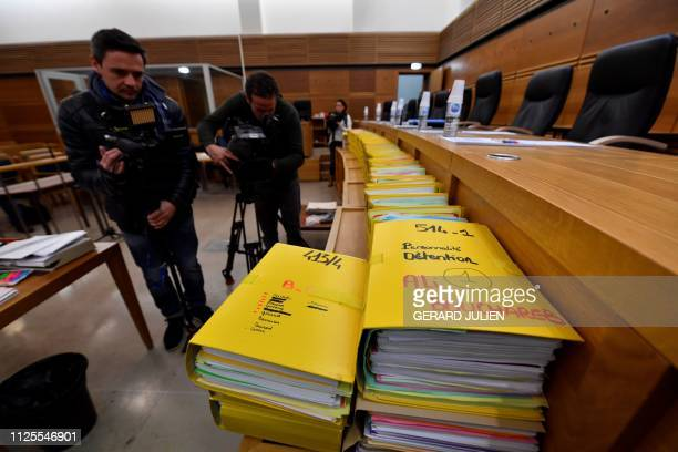 Journalists take images of the files on February 18 2019 at the Assize Court of AixEnProvence southern France ahead of a court hearing in the trial...
