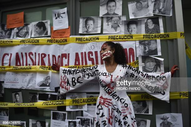 Journalists take part in a protest to mark one month since the murder of their colleague Javier Valdez a noted expert on the country's drug cartels...