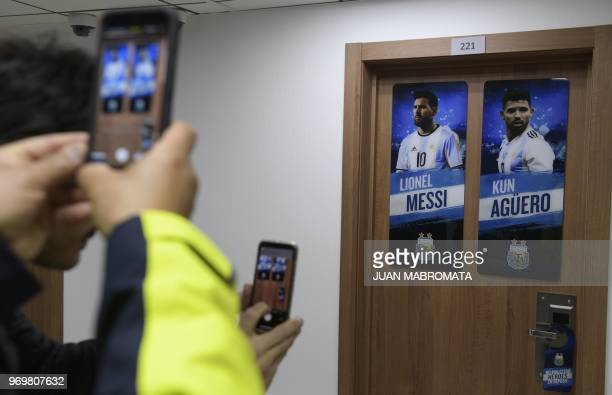 Journalists take photographs of the door of the room of Lionel Messi and Sergio Aguero at Argentina's base camp in Bronnitsy south of Moscow on June...